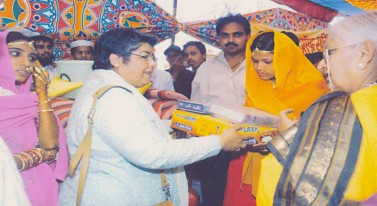 Gifts being distributed by Ms. Parul Devidas Joint Secretary Women and Child Development, New Delhi.