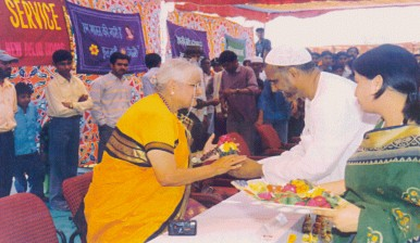 Dr.V.Mohini Giri presenting  flowers to the distinguished guests